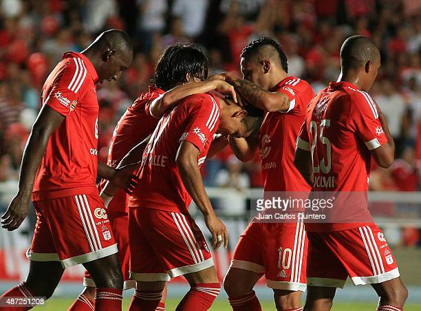 Ayron del Valle of America de Cali celebrates with his teammates after scoring the third goal of his team during a match between America de Cali and...