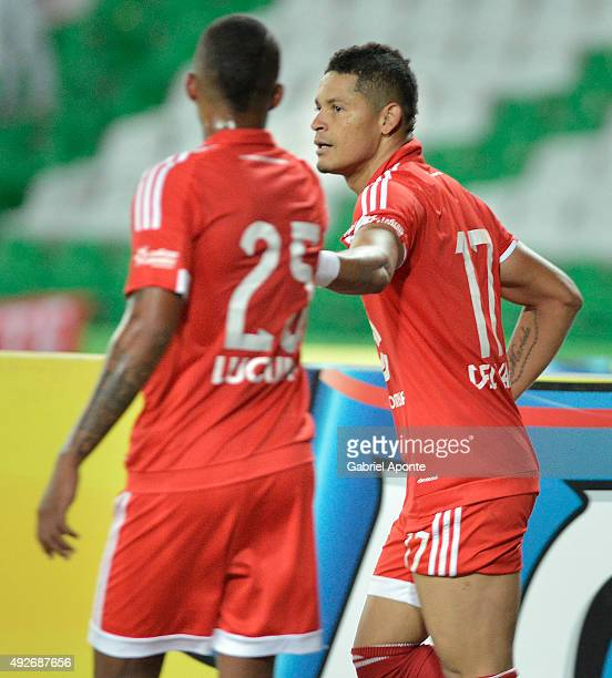 Ayron del Valle of America de Cali celebrates with Sebastian Viafara after scoring the second goal of his team during a match between Deportes...