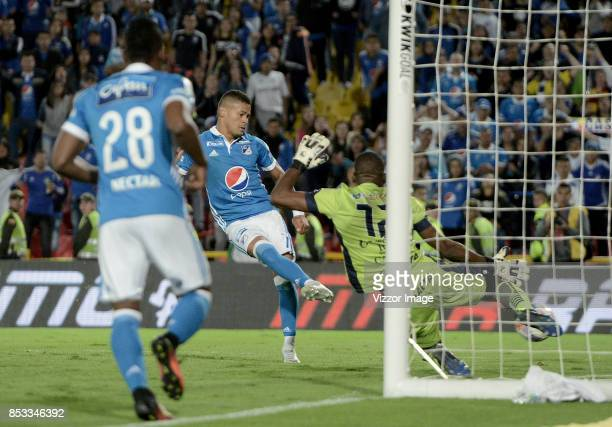 Ayron del Valle of Millonarios shots to score the first goal of his team during a match between Millonarios and Deportivo Pasto as part of Liga...