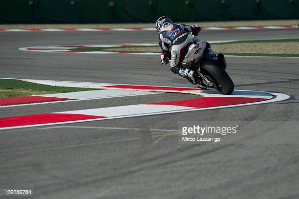 Ayrton Badovini of Italy and BMW Motorrad Italia SBK Team rounds the bend during the qualifying practice of Superbike World Championship Round Eleven...