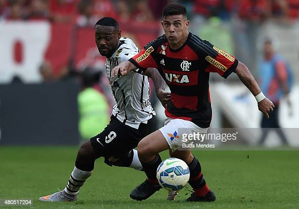 Ayrton of Flamengo struggles for the ball with Vagner Love of Corinthians during a match between Flamengo and Corinthians as part of Brasileirao...