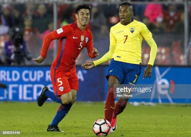 Ayrton Preciado of Ecuador fights for the ball with Francisco Silva of Chile during a match between Chile and Ecuador as part of FIFA 2018 World Cup...