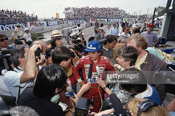 Ayrton Senna driver of the Honda Marlboro McLaren MP46 Honda 35 V12 holds an interview with the media during the Iceberg United States Grand Prix on...