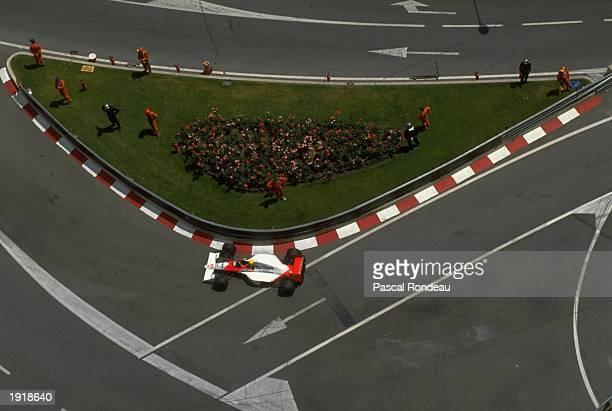 Ayrton Senna of Brazil cuts close to a corner in his McLaren Honda during the Monaco Grand Prix at the Monte Carlo circuit in Monaco Senna finished...