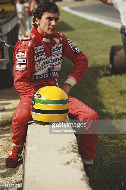 Ayrton Senna of Brazil driver of the Honda Marlboro McLaren McLaren MP4/5B Honda RA109E V10 sits on a wall after retiring during the Spanish Grand...
