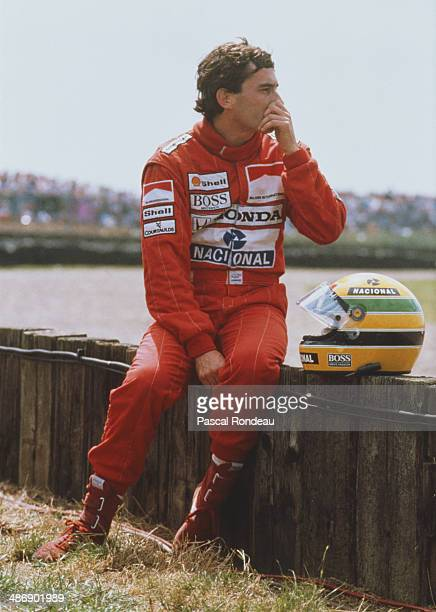 Ayrton Senna of Brazil driver of the Honda Marlboro McLaren McLaren MP4/5 Honda V10 watches the race after spinning out during the British Grand Prix...