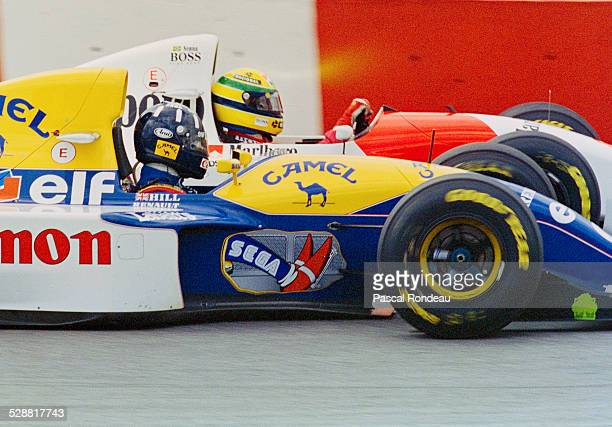 Ayrton Senna of Brazil drives the Marlboro McLaren MP4/8Ford HBE7 V8 alongside Damon Hill driver of the Canon Williams Renault Williams FW15C Renault...