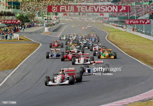Ayrton Senna of Brazil drives the Marlboro McLarenMcLaren MP4/8Ford HBE7 V8 ahead of Alain Prost and the field at the start of Japanese Grand Prix on...