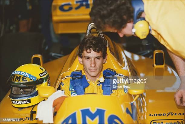 Ayrton Senna of Brazil sits aboard the Camel Team Lotus Honda Lotus 99T Honda RA166E V6 turbo during practice for the Brazilian Grand Prix on 11th...