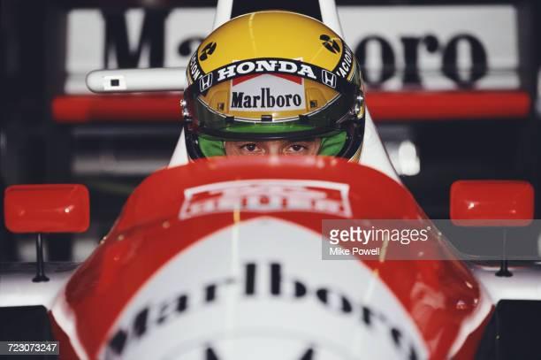 Ayrton Senna of Brazil sits aboard the Honda Marlboro McLaren McLaren MP4/6 Honda V12 during practice for the Iceberg United States Grand Prix on 9...