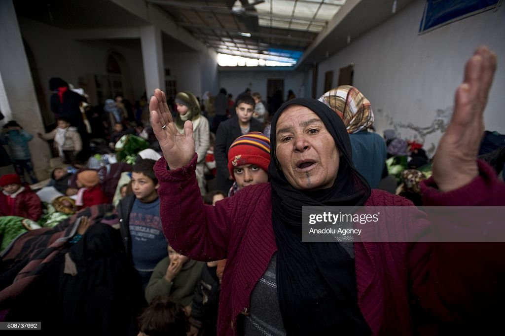 Ayse Asker, a Turkmen woman who fled bombing in Aleppo, speaks after she took shelter at the courtyard of a mosque at the Oncupinar crossing, opposite the Turkish province of Kilis, near Azaz town of Aleppo, Syria on February 6, 2016. Thousands of Syrians have massed on the Syrian side of the border seeking refuge in Turkey.