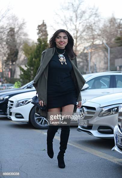 Aysegul Uluc poses wearing parka by Asos cloth by Zara high boot by Stuart Weitzman hand bag by Bottega Veneta charm by HM during Mercedes Benz...