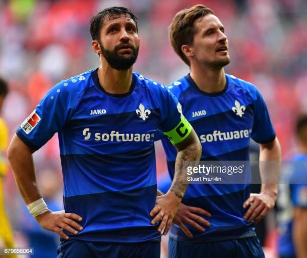 Aytac Sulu and Sandro Sirigu of Dramstadt look dejected after the Bundesliga match between Bayern Muenchen and SV Darmstadt 98 at Allianz Arena on...