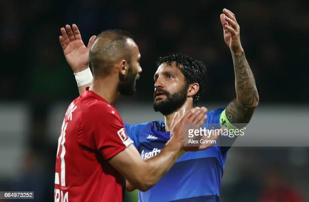 Aytac Sulu of Darmstadt and Oemer Toprak of Leverkusen react during the Bundesliga match between SV Darmstadt 98 and Bayer 04 Leverkusen at Jonathan...