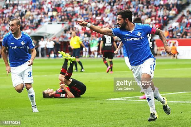 Aytac Sulu of Darmstadt celebrates his team's first goal during the Bundesliga match between Bayer Leverkusen and SV Darmstadt 98 at BayArena on...