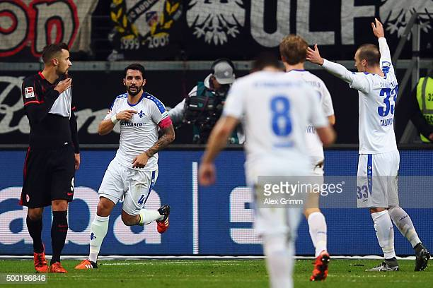 Aytac Sulu of Darmstadt celebrates his team's first goal during the Bundesliga match between Eintracht Frankfurt and SV Darmstadt 98 at...