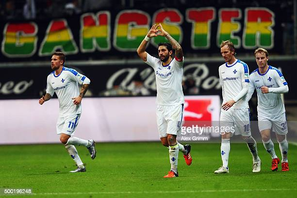 Aytac Sulu of Darmstadt celebrates his team's first goal with team mates during the Bundesliga match between Eintracht Frankfurt and SV Darmstadt 98...