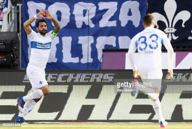Aytac Sulu of Darmstadt celebrates his team's first goal with team mate Sidney Sam during the Bundesliga match between SV Darmstadt 98 and 1 FSV...