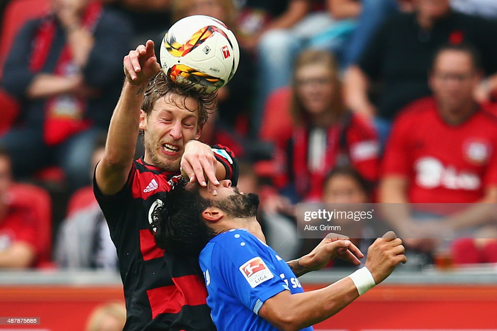 Aytac Sulu of Darmstadt is challenged by Stefan Kiessling of Leverkusen during the Bundesliga match between Bayer Leverkusen and SV Darmstadt 98 at...
