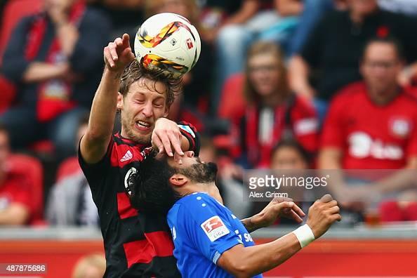Aytac Sulu of Darmstadt is challenged by Stefan Kiessling of Leverkusen during the Bundesliga match between Bayer Leverkusen and SV Darmstadt 98 at...
