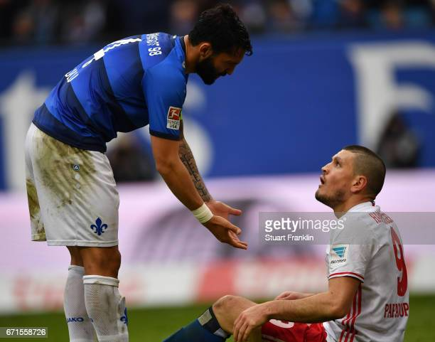 Aytac Sulu of Darmstadt offers a helping hand to Kyriakos Papadopoulos of Hamburg during the Bundesliga match between Hamburger SV and SV Darmstadt...