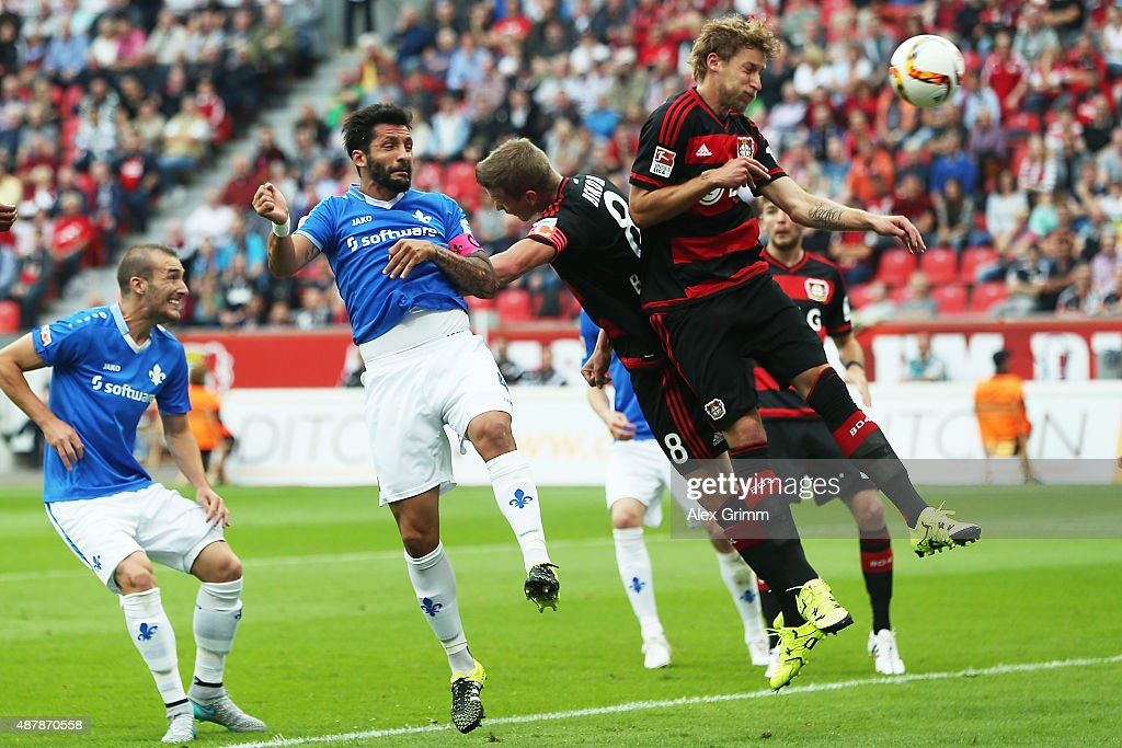 Aytac Sulu of Darmstadt scores his team's first goal against Lars Bender and Stefan Kiessling of Leverkusen during the Bundesliga match between Bayer...