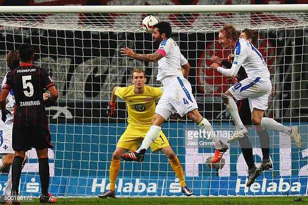 Aytac Sulu of Darmstadt scores his team's first goal against goalkeeper Lukas Hradecky of Frankfurt during the Bundesliga match between Eintracht...