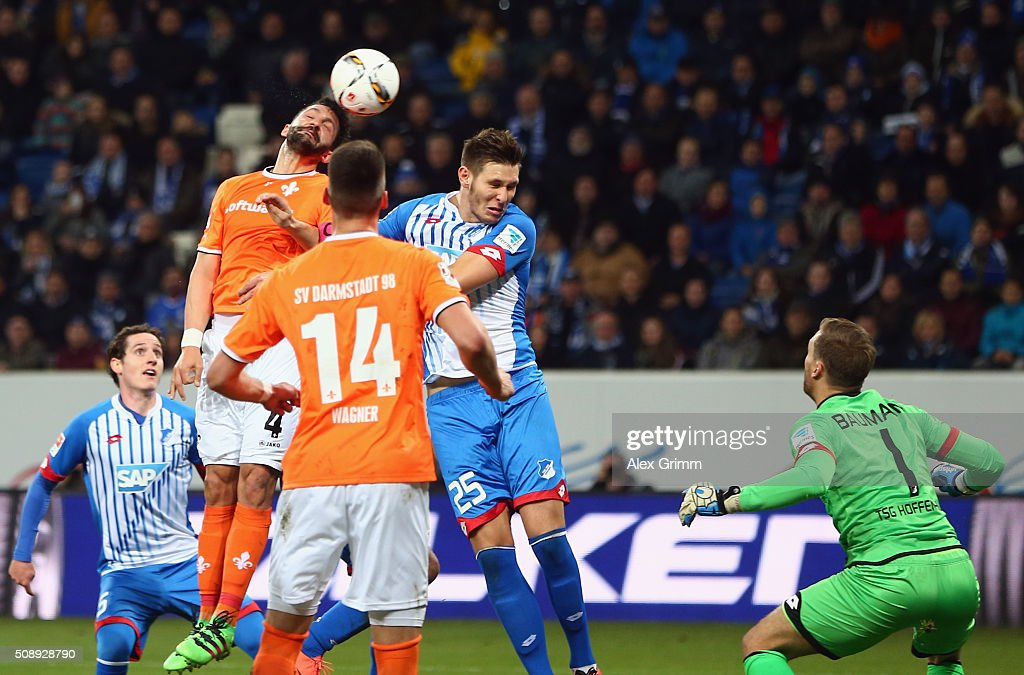 Aytac Sulu (L) of Darmstadt scores his team's first goal against <a gi-track='captionPersonalityLinkClicked' href=/galleries/search?phrase=Niklas+Suele&family=editorial&specificpeople=7140936 ng-click='$event.stopPropagation()'>Niklas Suele</a> and goalkeeper <a gi-track='captionPersonalityLinkClicked' href=/galleries/search?phrase=Oliver+Baumann&family=editorial&specificpeople=4645207 ng-click='$event.stopPropagation()'>Oliver Baumann</a> of Hoffenheim during the Bundesliga match between 1899 Hoffenheim and SV Darmstadt 98 at Wirsol Rhein-Neckar-Arena on February 7, 2016 in Sinsheim, Germany.