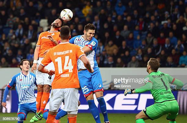 Aytac Sulu of Darmstadt scores his team's first goal against Niklas Suele and goalkeeper Oliver Baumann of Hoffenheim during the Bundesliga match...
