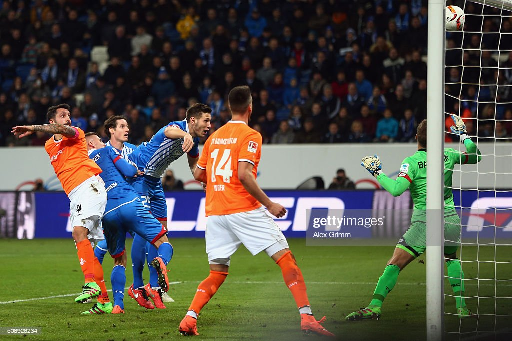 Aytac Sulu (L) of Darmstadt scores his team's first goal against goalkeeper <a gi-track='captionPersonalityLinkClicked' href=/galleries/search?phrase=Oliver+Baumann&family=editorial&specificpeople=4645207 ng-click='$event.stopPropagation()'>Oliver Baumann</a> of Hoffenheim during the Bundesliga match between 1899 Hoffenheim and SV Darmstadt 98 at Wirsol Rhein-Neckar-Arena on February 7, 2016 in Sinsheim, Germany.