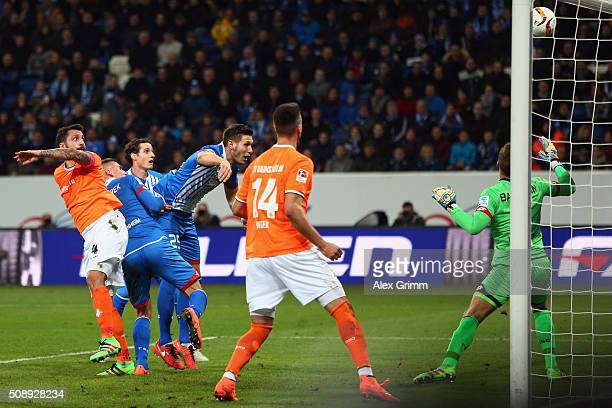Aytac Sulu of Darmstadt scores his team's first goal against goalkeeper Oliver Baumann of Hoffenheim during the Bundesliga match between 1899...