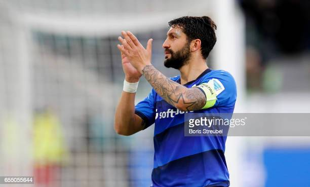 Aytac Sulu of SV Darmstadt 98 waves to his fans after losing the Bundesliga match between VfL Wolfsburg and SV Darmstadt 98 at Volkswagen Arena on...