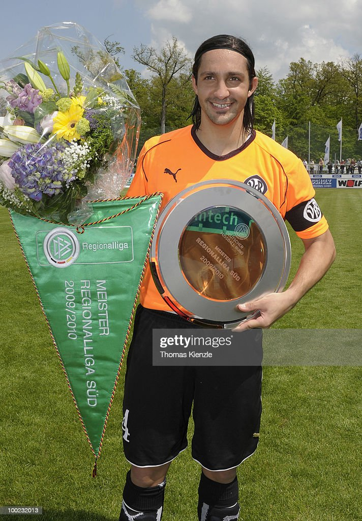 Aytac Sulu team captain of VfR Aalen presents the trophies for winning the championship prior to the Regionalliga match between VfR Aalen and...