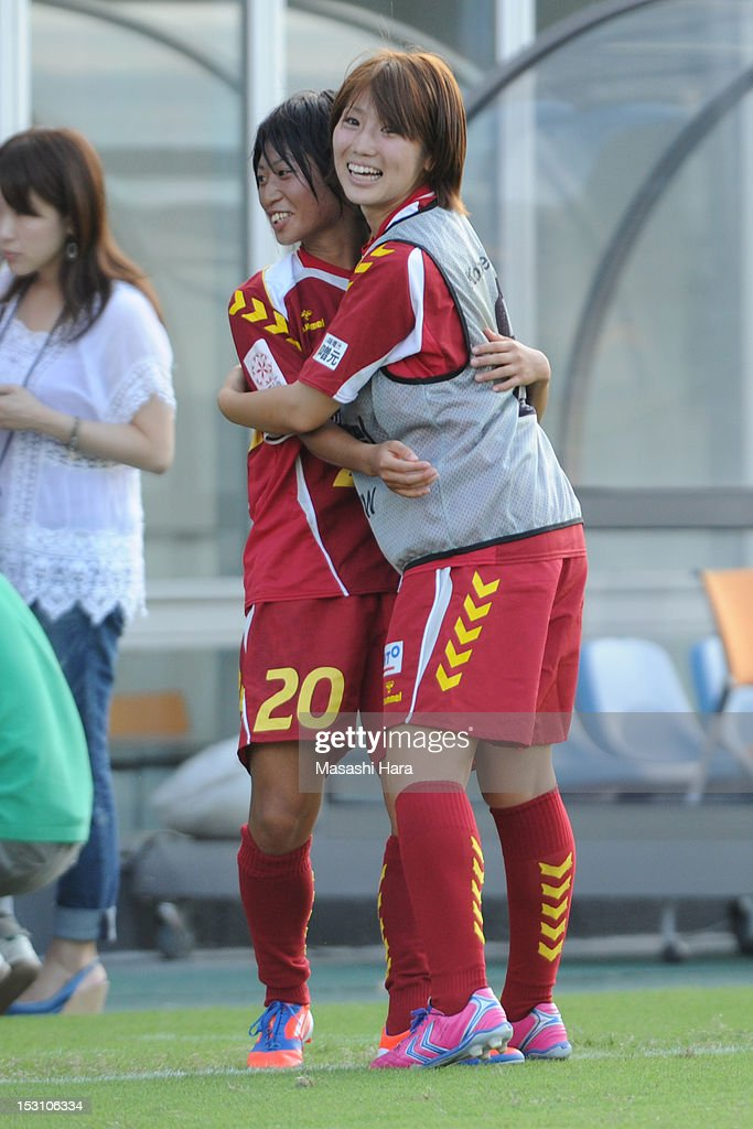 Ayu Nakada #13 of INAC Kobe Leonessa (R) celebrates with Yoko Tanaka after victory in the Nadeshiko League match between AS Elfen Sayama and INAC Kobe Leonessa at NACK 5 Stadium Omiya on September 30, 2012 in Saitama, Japan.