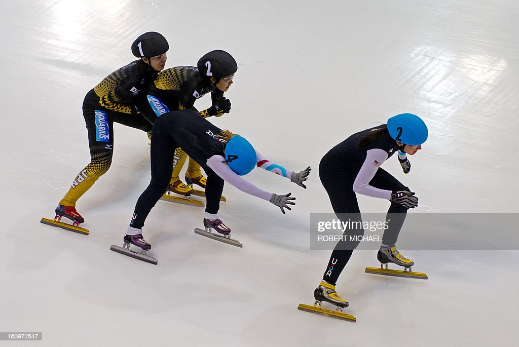 Ayuko Ito and Biba Sakurai of team Japan and Jessica Smith and Alyson Dudek of the US compete in the women's 3000m relay heat race of the ISU World Cup short track speed skating event in Dresden, eastern Germany, on February 8, 2013.