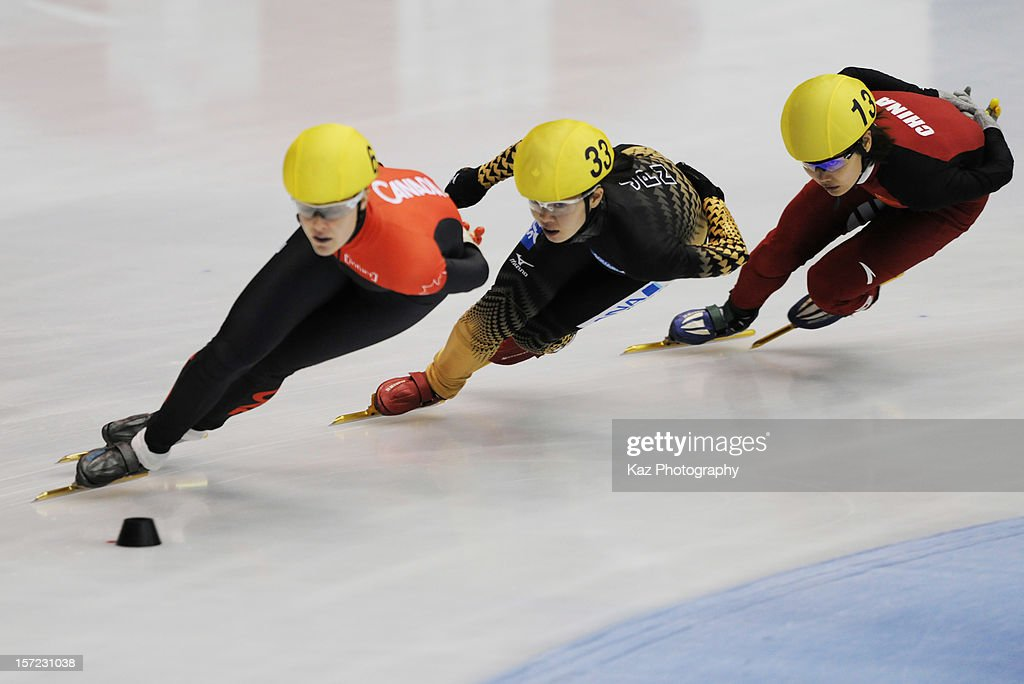 Ayuko Ito of Japan chases Jessica Gregg of Canada in Race 1 of Ladies 1500m Heats during day one of the ISU World Cup Short Track at Nippon Gaishi...