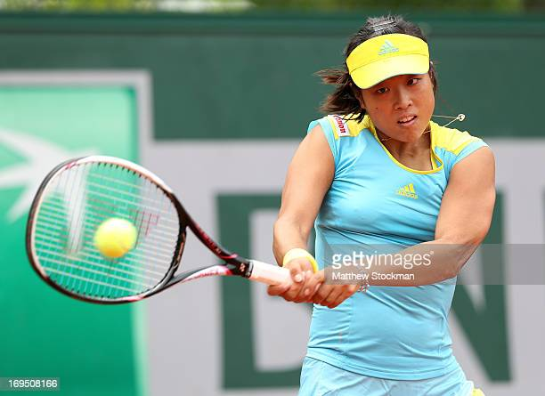 Ayumi Morita of Jaoan plays a backhand in her Women's Singles match against Yulia Putintseva of Kazakhstan during day one of the French Open at...