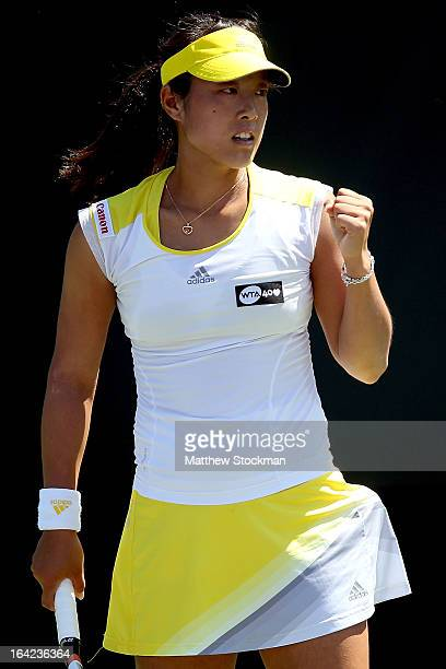 Ayumi Morita of Japan celebrates a point against Yanina Wickmayer of Belgium during the Sony Open at Crandon Park Tennis Center on March 21 2013 in...