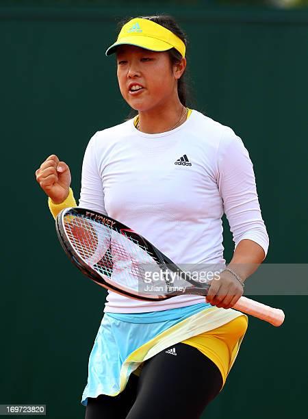 Ayumi Morita of Japan celebrates a point during the Women's Doubles match between Simona Halep of Romania and Arantxa Rus of Netherlands and Sorana...