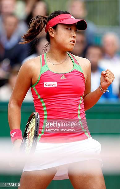 Ayumi Morita of Japan celebrates a point during the women's singles round two match between Yanina Wickmayer of Belgium and Ayumi Morita of Japan on...