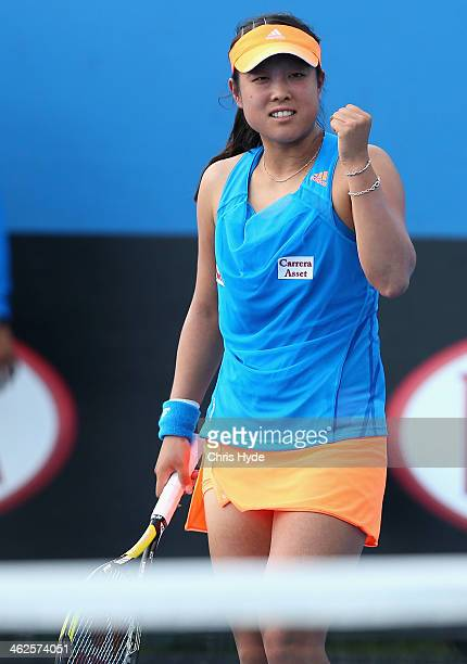 Ayumi Morita of Japan celebrates a point in her first round match against Nadiya Kichenok of the Ukraine during day two of the 2014 Australian Open...