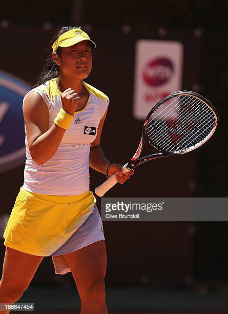 Ayumi Morita of Japan celebrates match point against Sorana Cirstea of Romania in their first round match during day two of the Internazionali BNL...