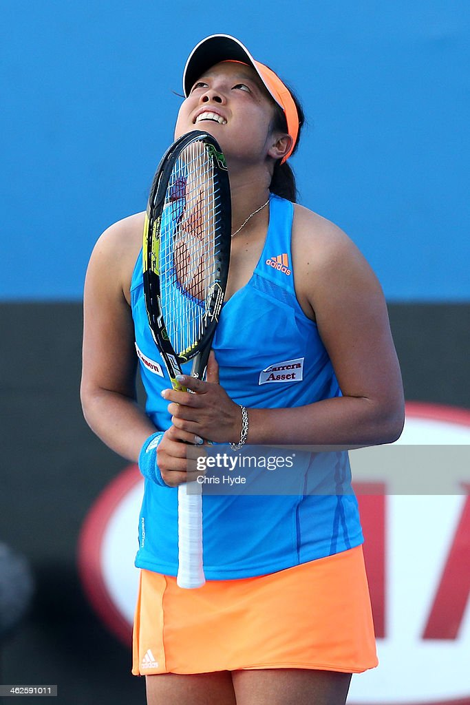 <a gi-track='captionPersonalityLinkClicked' href=/galleries/search?phrase=Ayumi+Morita&family=editorial&specificpeople=569402 ng-click='$event.stopPropagation()'>Ayumi Morita</a> of Japan celebrates winning her first round match against Nadiya Kichenok of the Ukraine during day two of the 2014 Australian Open at Melbourne Park on January 14, 2014 in Melbourne, Australia.