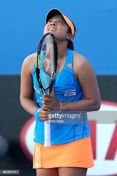Ayumi Morita of Japan celebrates winning her first round match against Nadiya Kichenok of the Ukraine during day two of the 2014 Australian Open at...