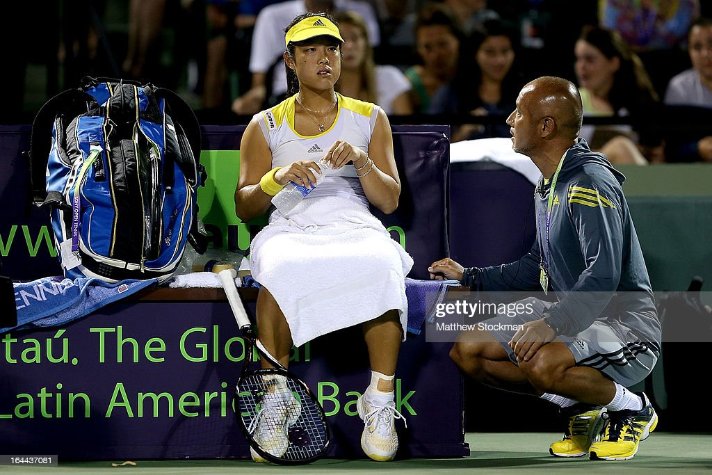 Ayumi Morita of Japan confers with her coach Junichi Maruyama while playing Serena Williams during the Sony Open at Crandon Park Tennis Center on March 23, 2013 in Key Biscayne, Florida.