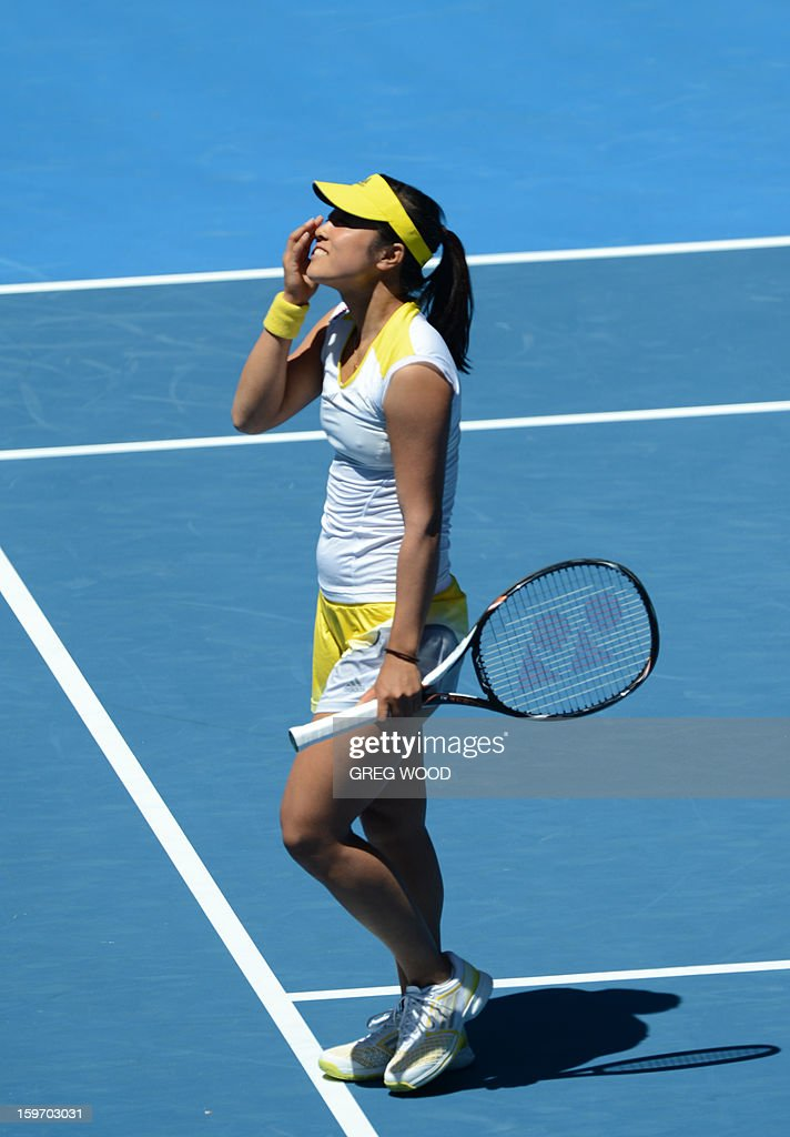Ayumi Morita of Japan gestures during her women's singles match against Serena Williams of the US on the sixth day of the Australian Open tennis tournament in Melbourne on January 19, 2013.