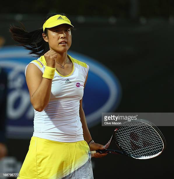 Ayumi Morita of Japan in action during her second round match against Urszula Radwanska of Poland on day four of the Internazionali BNL d'Italia 2013...