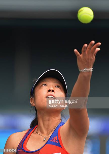 Ayumi Morita of Japan in action during her women's singles first round match against Laura Robson of Great Britain during day two of the Toray Pan...