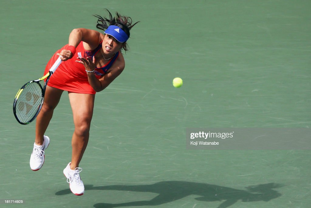 <a gi-track='captionPersonalityLinkClicked' href=/galleries/search?phrase=Ayumi+Morita&family=editorial&specificpeople=569402 ng-click='$event.stopPropagation()'>Ayumi Morita</a> of Japan in action during her women's singles second round match against Jelena Jankovic of Serbia during day three of the Toray Pan Pacific Open at Ariake Colosseum on September 24, 2013 in Tokyo, Japan.