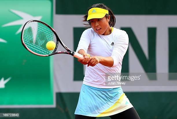 Ayumi Morita of Japan in action during the Women's Doubles match between Simona Halep of Romania and Arantxa Rus of Netherlands and Sorana Cirstea of...